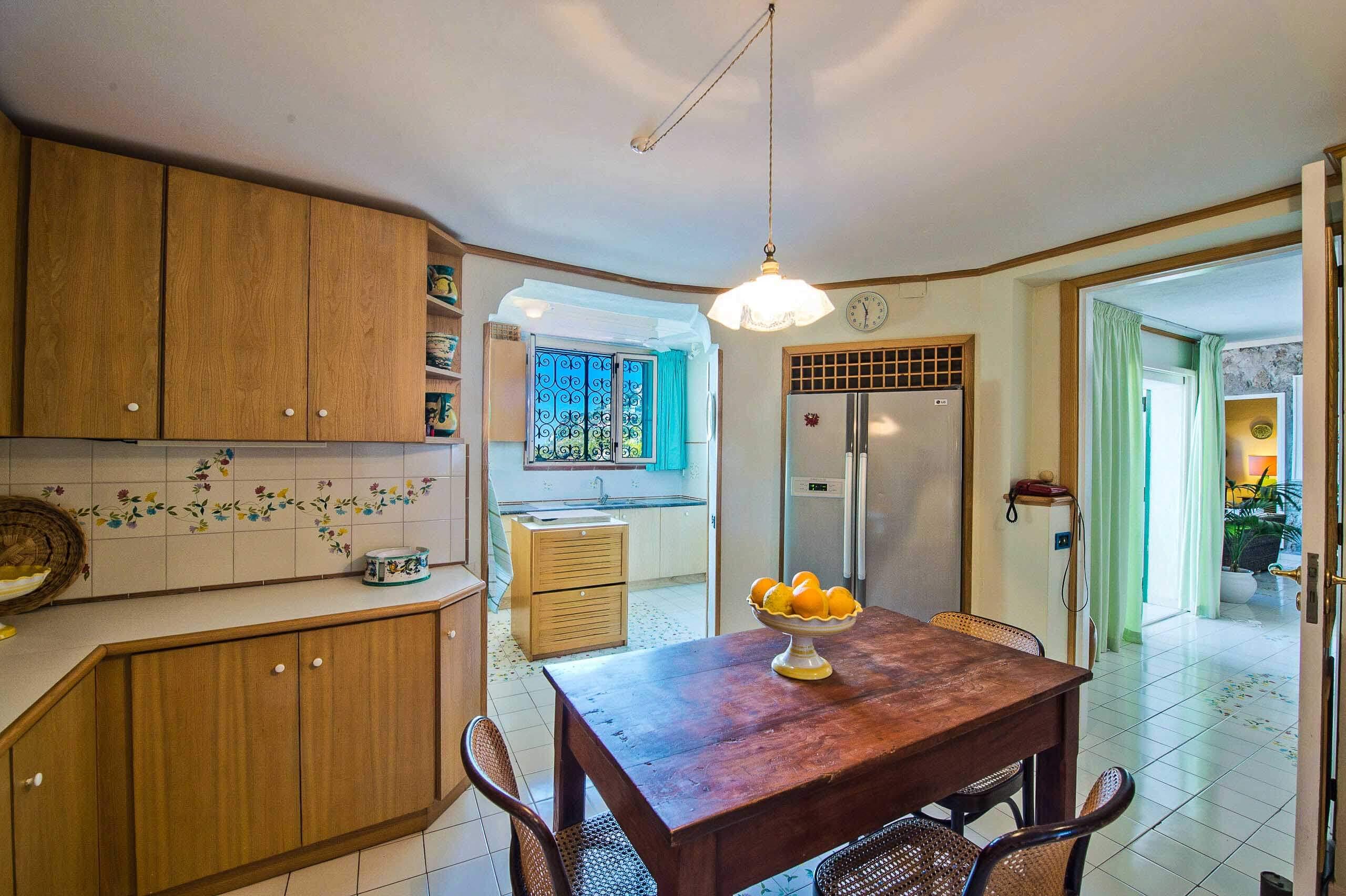 inside:large kitchen with fridge