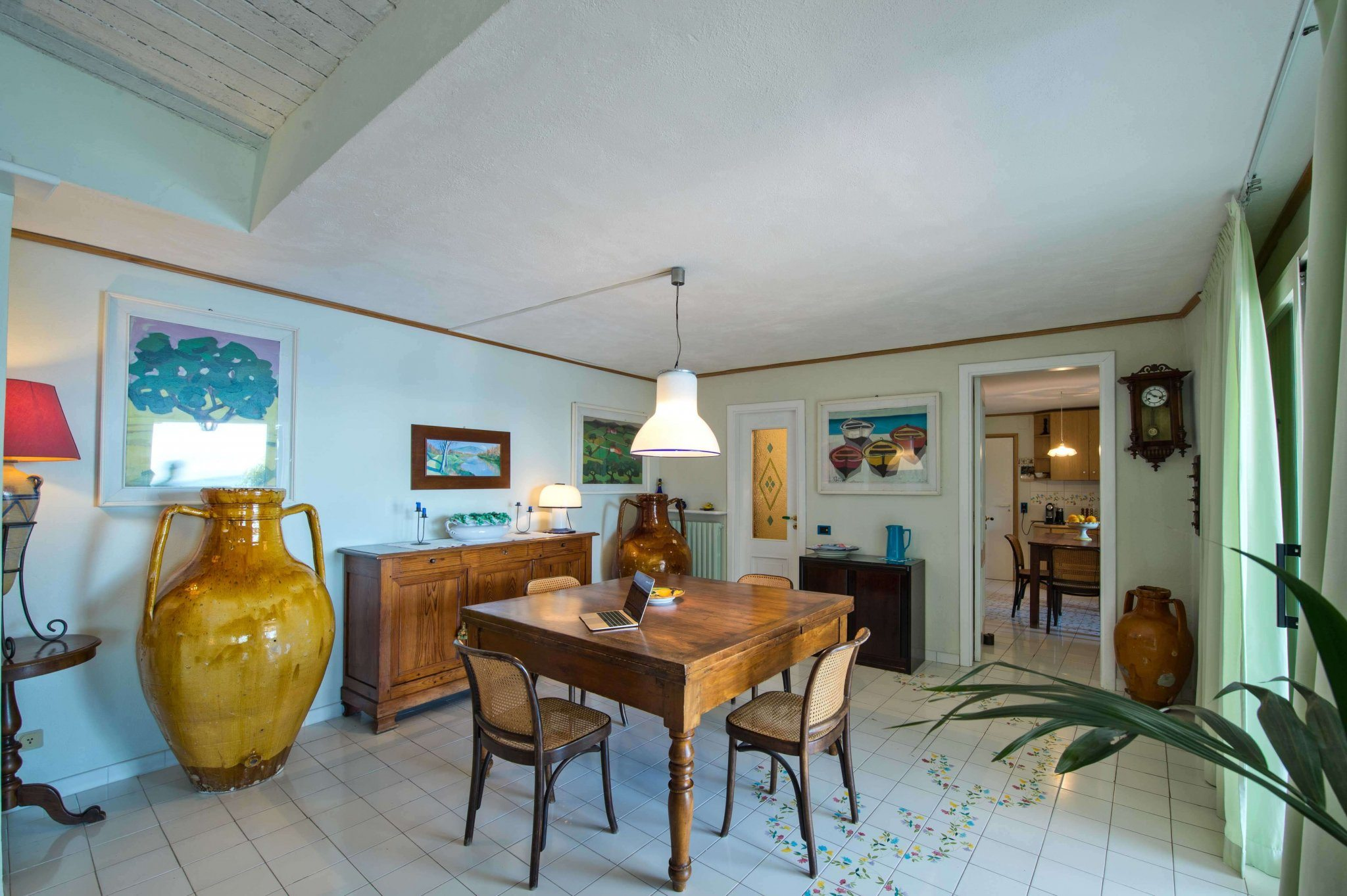 inside main living  with antique dining table